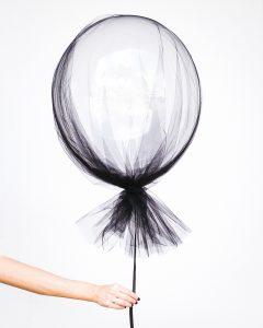 Hand holding a balloon