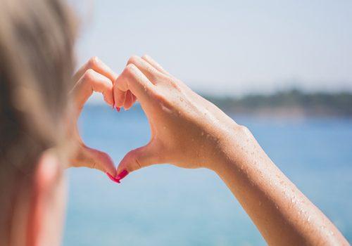 Hand forming a heart - egenomsorg